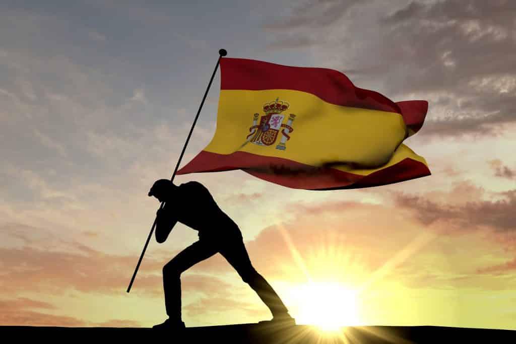 bandera españa siendo clavada