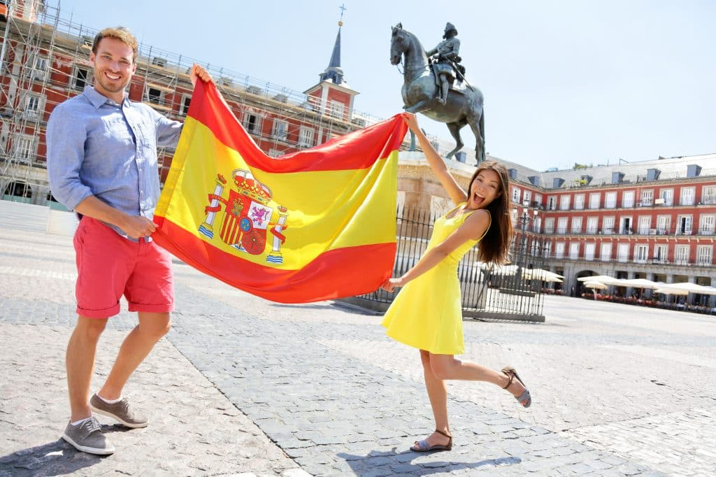 turistas bandera españa